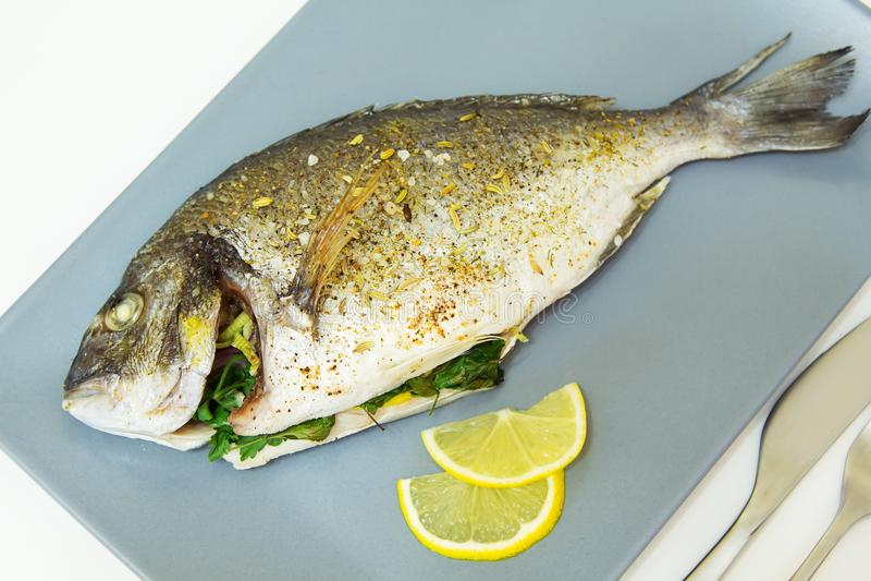 Baked fish dorado. Close-up, selective focus stock photos
