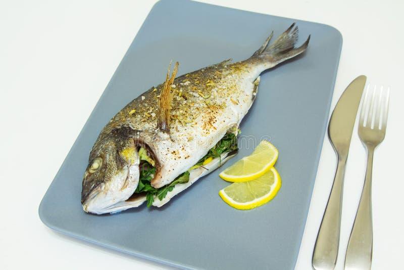 Baked fish dorado. Close-up, selective focus royalty free stock image
