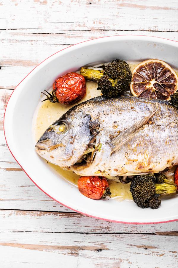 Baked in oven sea fish dorado stock image