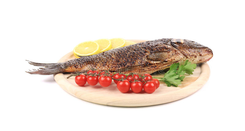 Download Baked fish on wooden board stock image. Image of cooked - 38563211