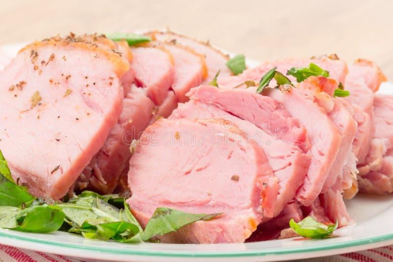Baked gammon ham. Slices of baked gammon ham - studio shot royalty free stock photo