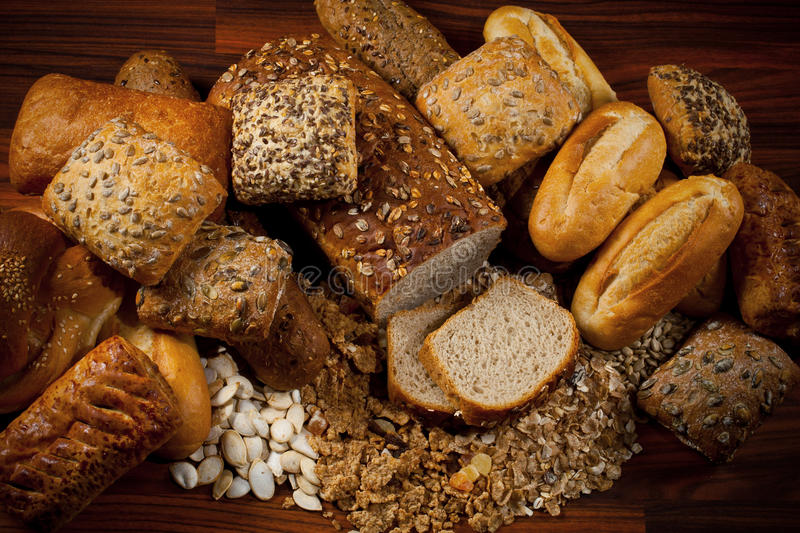 Baked goods. Assortment of baked goods in wood background stock photography