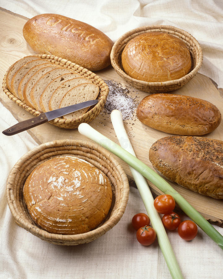 Baked goods. Various baked goods accompanied with leeks and tomatoes stock image