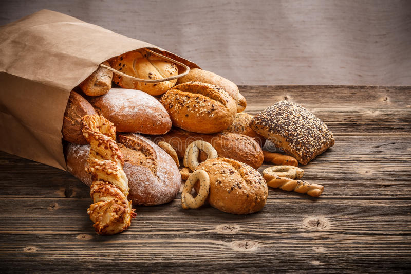 Baked goods. Assortment of baked goods on old wooden table stock photo