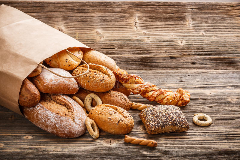 Baked goods. Assortment of baked goods on old wooden table royalty free stock images