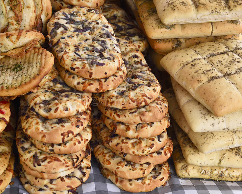 Baked goods at a bakery. Or market stall. Various pastries arrangement on a market stall royalty free stock image