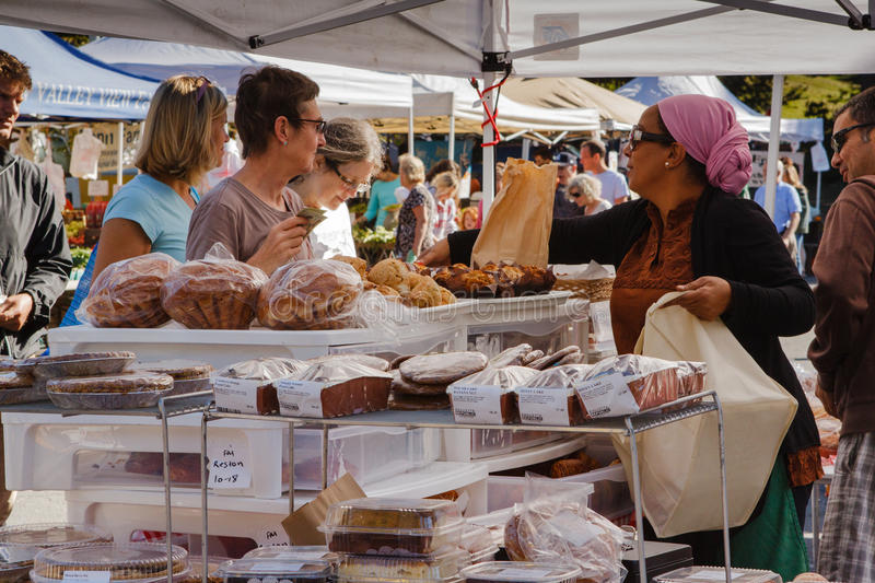 Baked Goods Farmers Market Virginia. Reston, Virginia community supports and encourages local vendors to sell baked goods at weekly Farmer's Market at Lake Anne stock photography