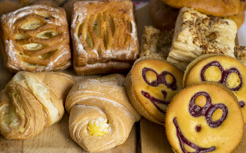 Baked goods. A variety of baked goods on a wooden table stock photography