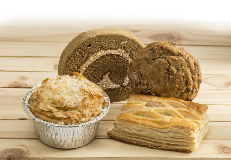 Baked goods. Various of baked goods on pine wood table stock images