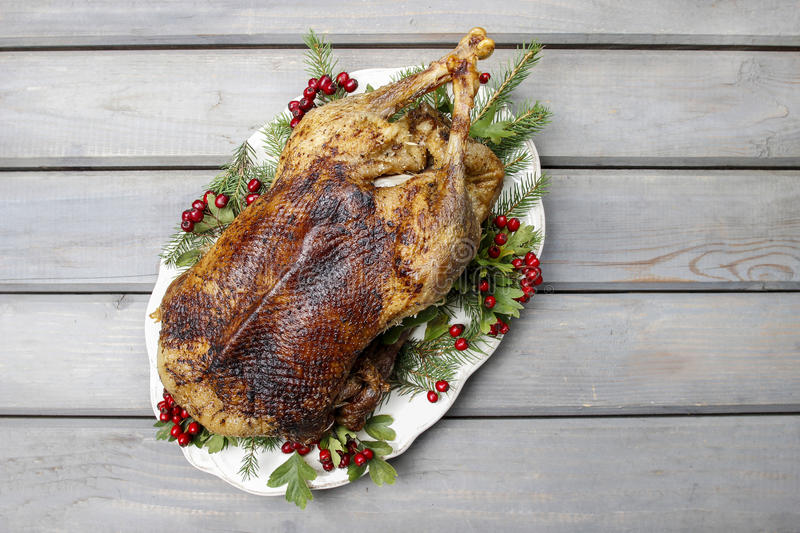 Baked goose on wooden table stock photos