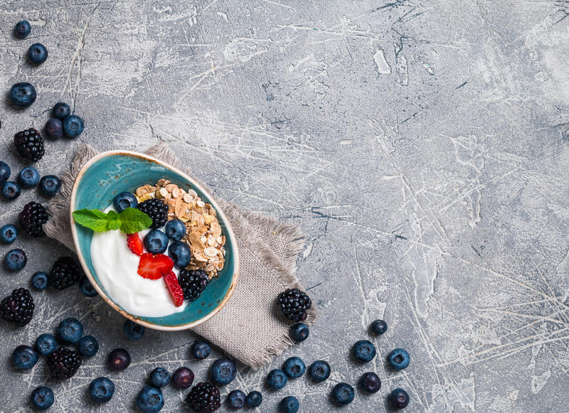 Baked granola with yogurt and berries royalty free stock image