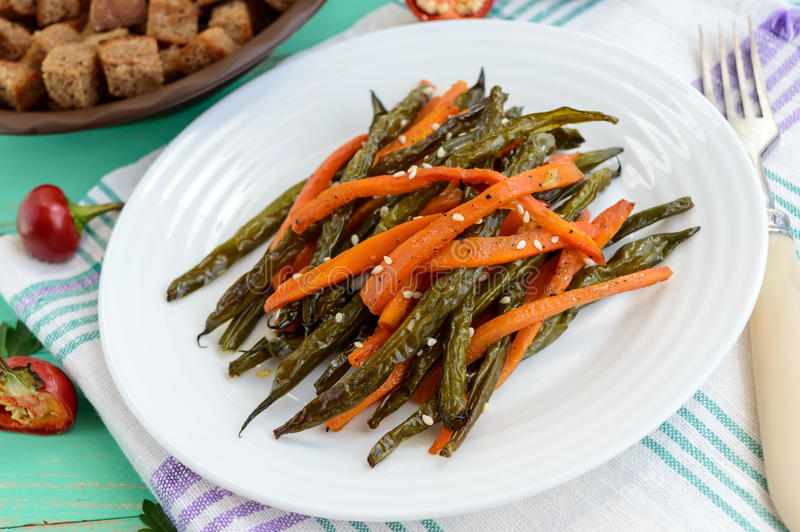 Baked green beans and carrots - vegan diets stock image
