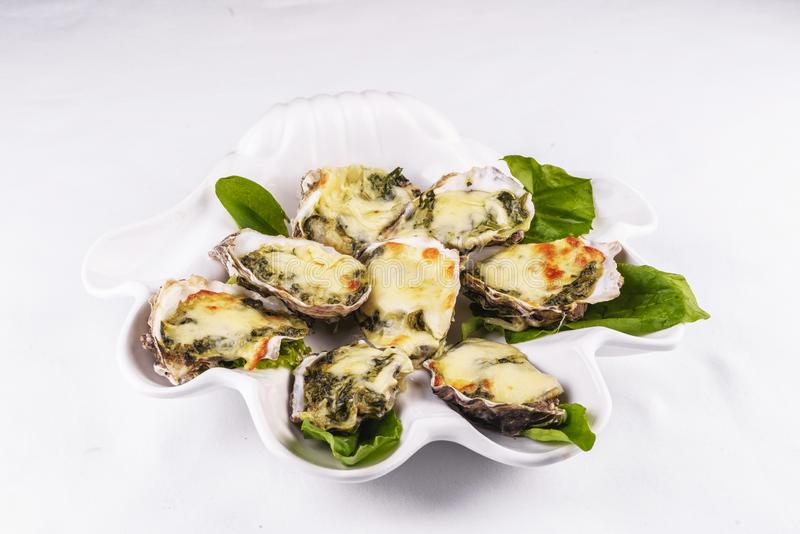 Baked with greens and cheese under the Mediterranean recipe stock photo