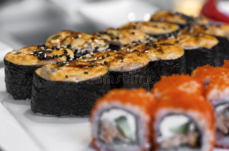 Baked Japanese sushi rolls royalty free stock photos