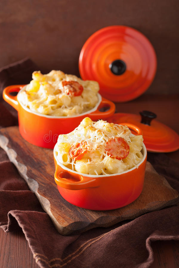Baked macaroni with cheese in orange casserole.  stock image
