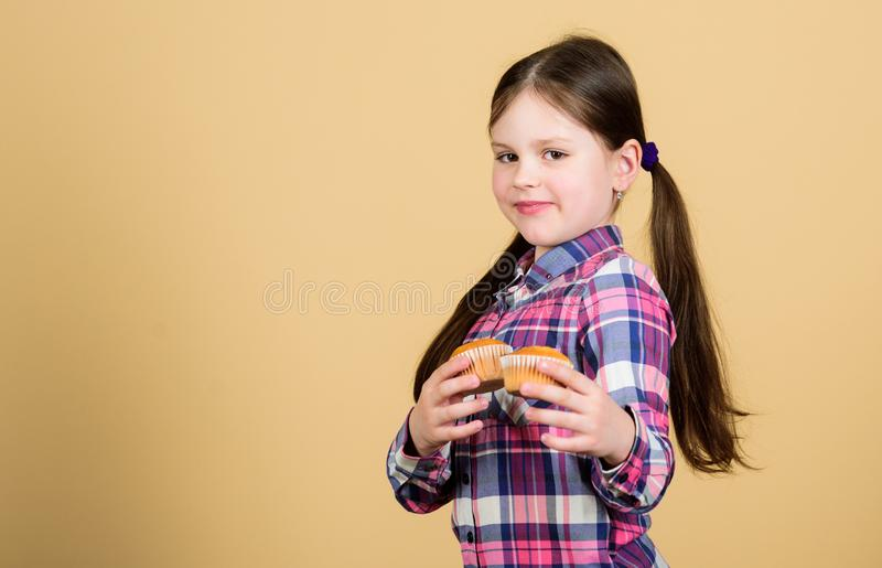 Baked by me. Cute small girl with freshly baked dessert food. Adorable little child holding home baked muffins. Baked. Cupcakes tastes so good, copy space stock photography