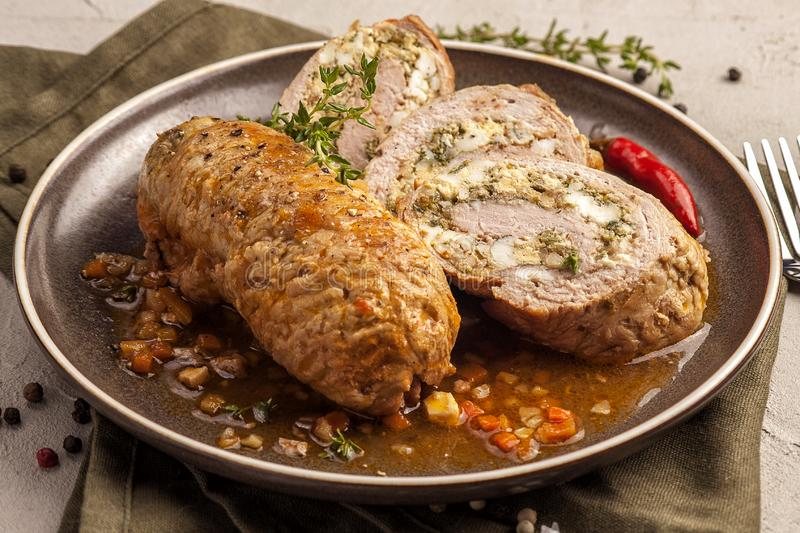 Baked meat rolls in a thick vegetable sauce stock image