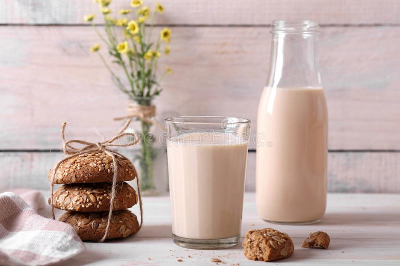 Baked milk with oatmeal cookies stock photos