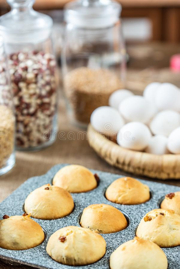 Baked muffins in baking dish royalty free stock photography