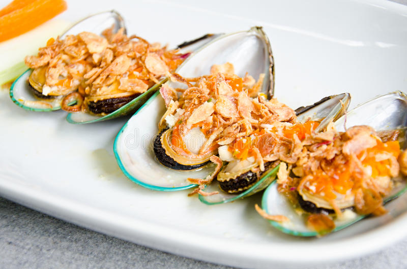 Baked mussels. stock photo