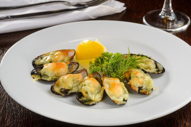 Baked mussels with cheese royalty free stock photography