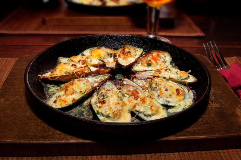 Baked MUSSELS for dinner stock images