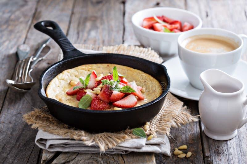 Baked pancake in cast iron pan royalty free stock photos