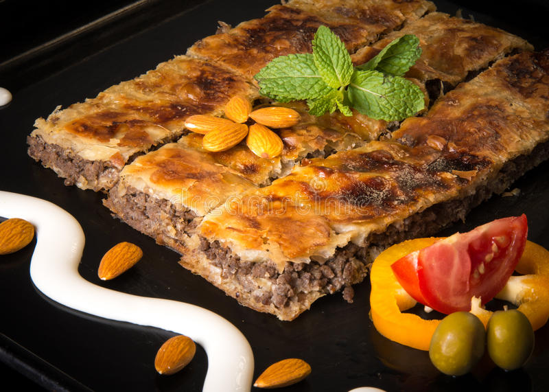 Baked pastry with mince. Arab Foods Goulash with mince stock images