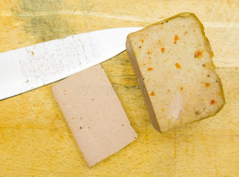 Baked pate on a wooden board. View from above. Baked pate and knife on a wooden board. View from above royalty free stock photography