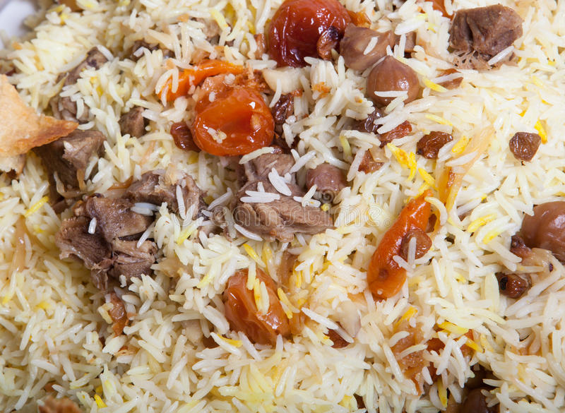 Baked pilaf dish. Freshly baked pilaf dish with meat and fruits stock photo