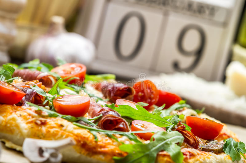 Baked pizza with ham royalty free stock photography