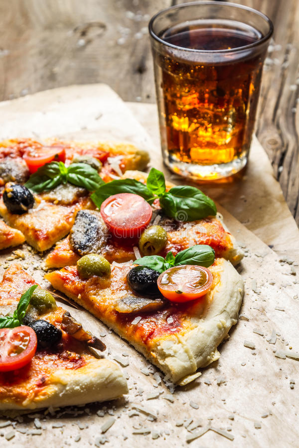Baked pizza and served with a cold drink royalty free stock photography