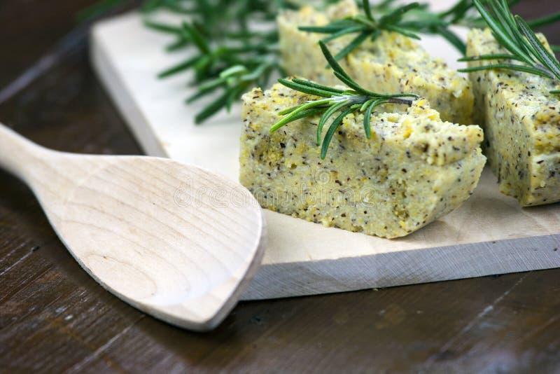 Baked polenta with italian cheese and rosemary royalty free stock image