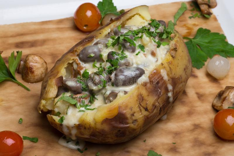 Baked potato. Filled with mushrooms stock photography