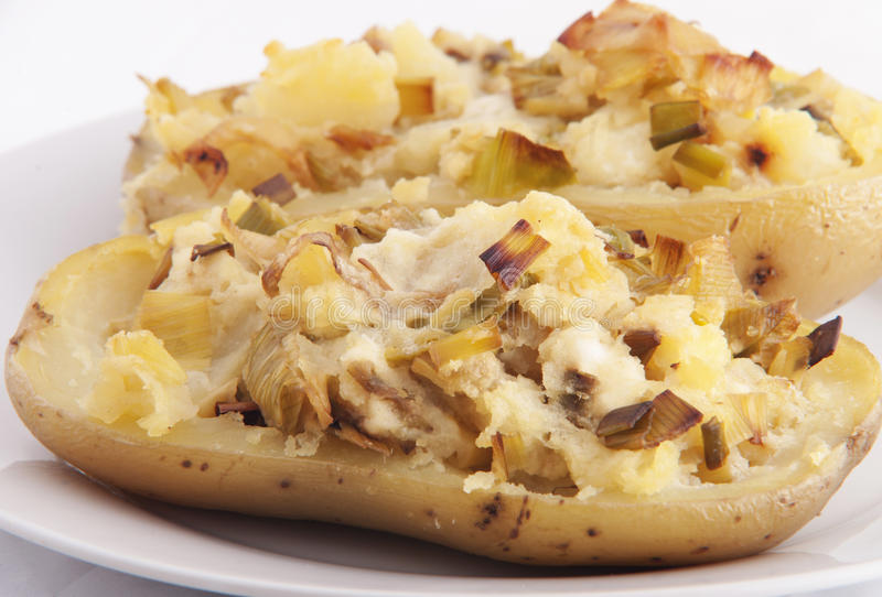 Baked potato stuffed with leek and cheese royalty free stock photos