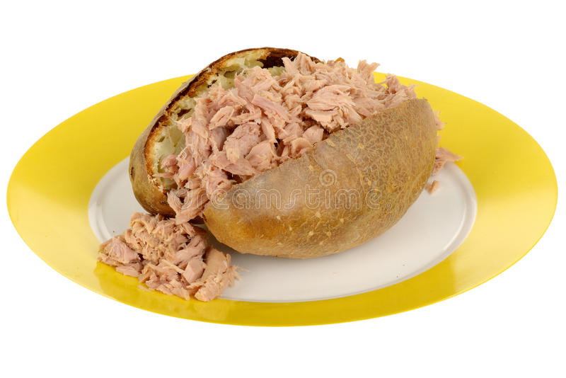 Baked potato with tuna fish filling on a plate stock photo for What goes good with fish