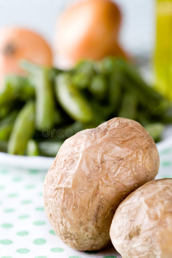 Baked potatoes. And french beans closeup on textile stock image