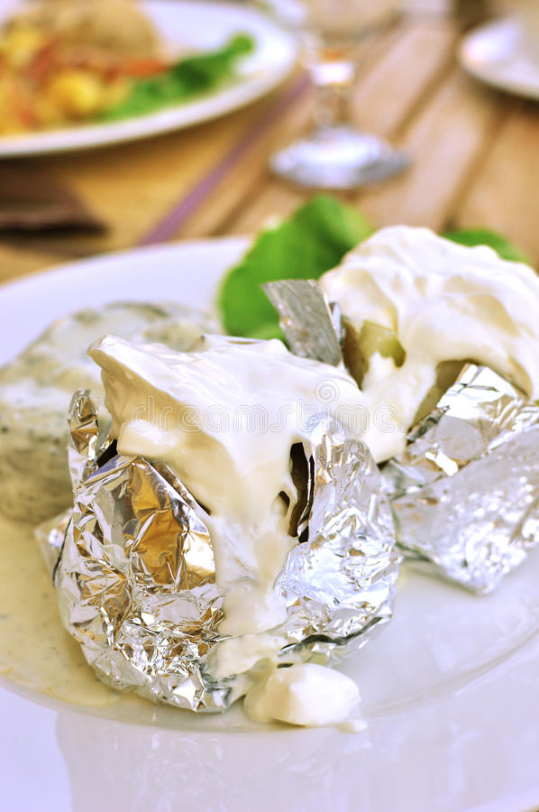 Baked Potatoes With Sour Cream Stock Photo