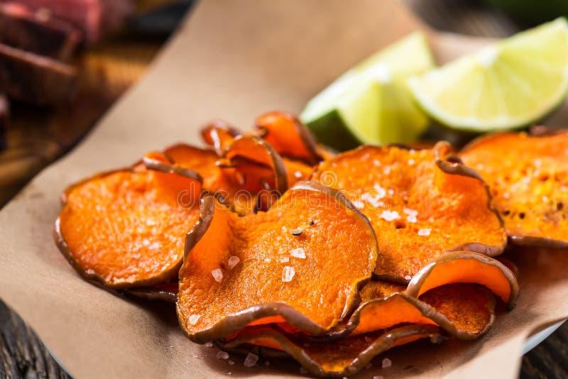Baked pumpkin chips stock photos
