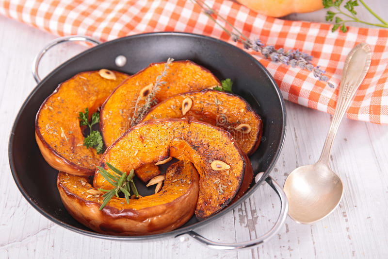 Baked pumpkin slices stock photography