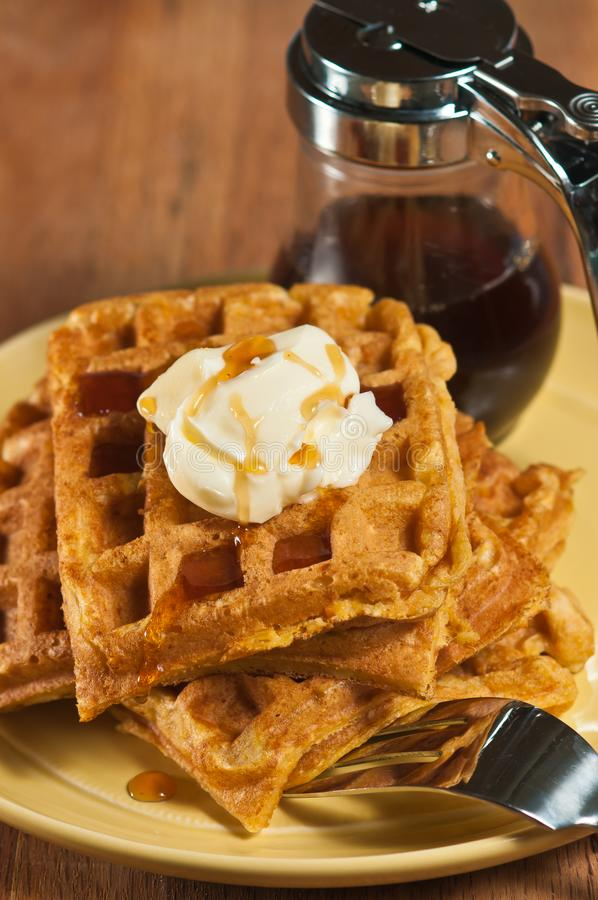 Baked pumpkin waffles with butter and syrup stock photo