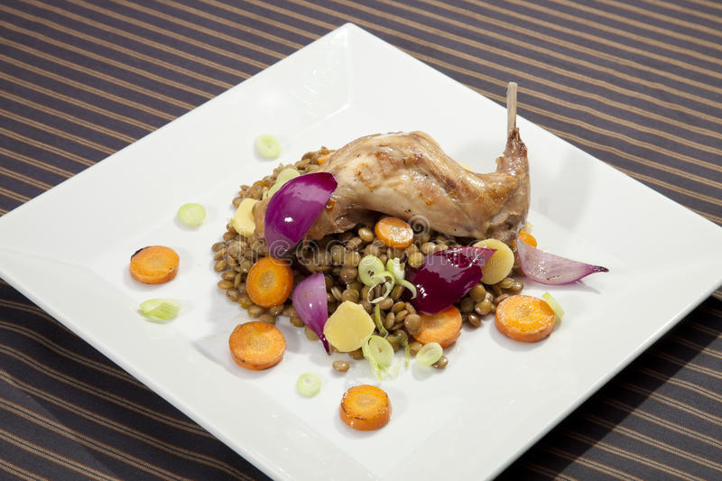 Baked Rabbit Leg With Lentil And Vegetable Royalty Free Stock Photo