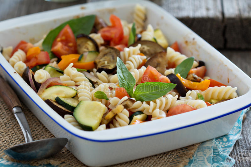 Baked ratatouille pasta. With zucchini, eggplant and tomatoes royalty free stock photo