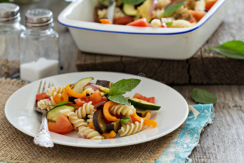 Baked ratatouille pasta. With zucchini, eggplant and tomatoes royalty free stock image
