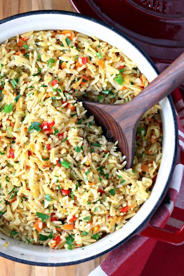 Baked Rice Pilaf. Rice pilaf with orzo and vegetables royalty free stock image