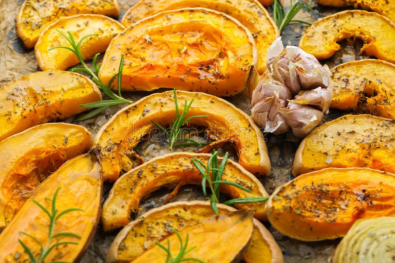 Baked roasted grilled orange pumpkin butternut squash and sweet potato. With herbs. Autumn food, soup ingredients. Kitchen background stock photography