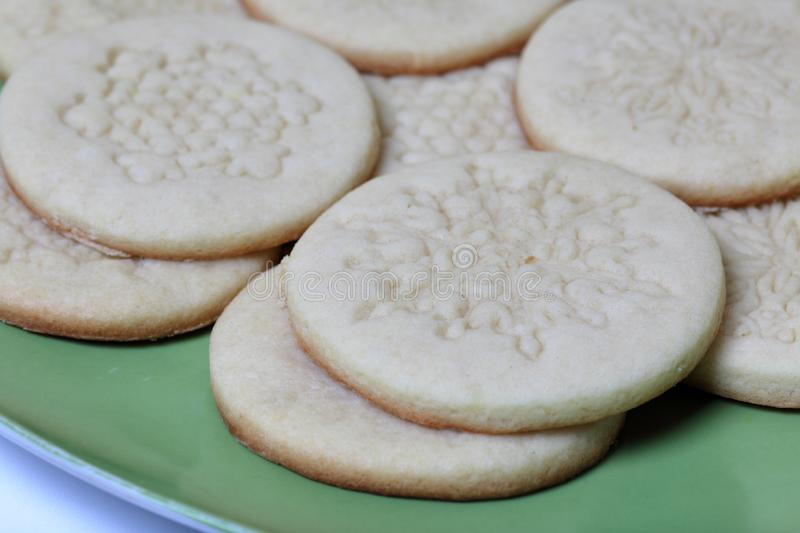 Baked round blanks from rolled dough with an ornament. For making marshmallow sandwiches. Lie on a plate.  royalty free stock image