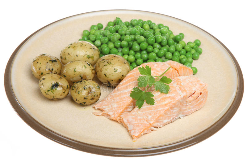 Baked Salmon Fillets. With new potatoes and peas stock images