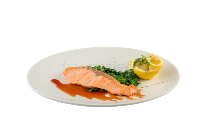 Baked Salmon Steak with Spinach and Lemon Slice stock images