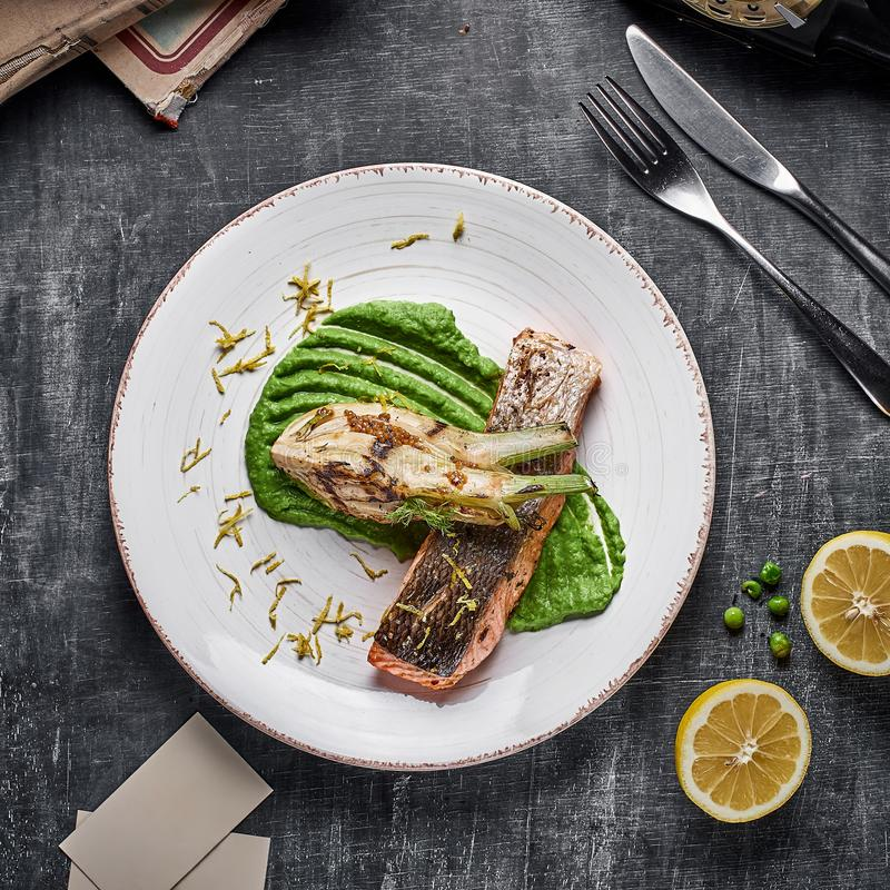 Free Baked Salmon Steak With Mashed Green Peas , Caramelized Onions And Lemon Stock Photo - 136517260